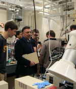 Students and faculty from Springfield Technical Community College visit an MIT lab before the Covid-19 pandemic.